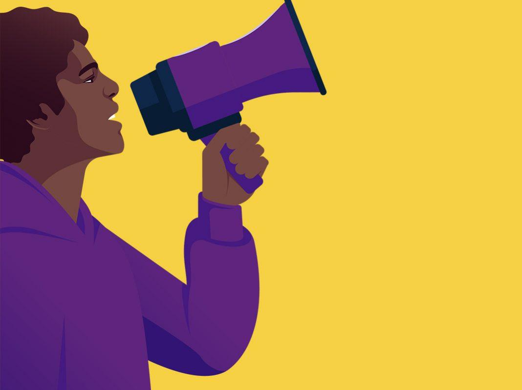 brand activism ragazzo che parla a un megafono viola immagine con sfondo giallo